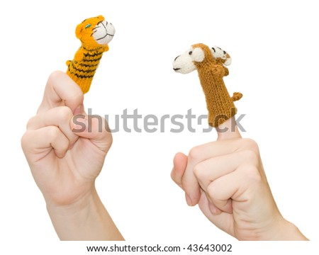 Finger-type theatre with puppets. Female hands and two fingers wearing puppets; monkey and tiger. Animal show. Finger theatre - stock photo