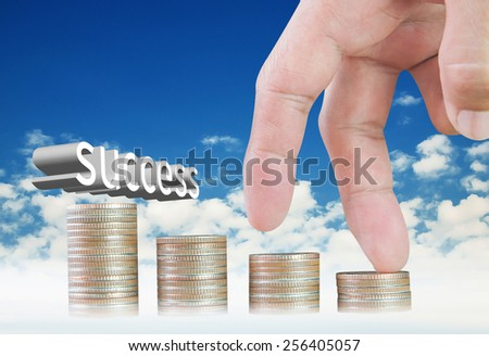 Finger walking up coin stack on blue sky background - stock photo
