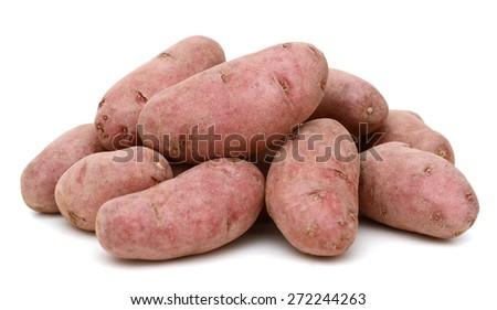 fingerling potatoes on white background - stock photo