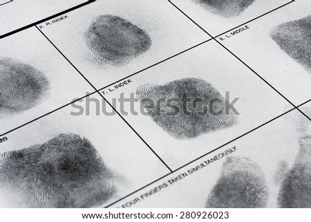 Fingerprint on police fingerprint card. - stock photo