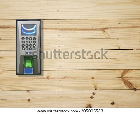 Fingerprint scanner on wood wall - stock photo