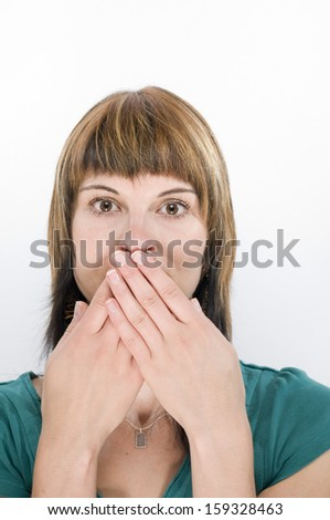 fingers at the mouth - stock photo