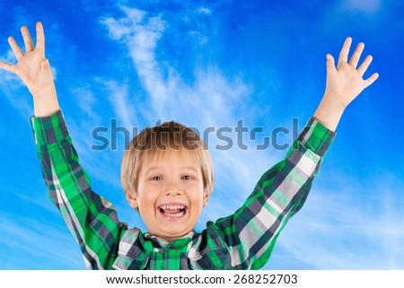 Fingers. Happy little child with smiley faces painted on his palms. Kid raising hands up. Ready for your text, symbol or logo. School concept. Isolated on white background - stock photo