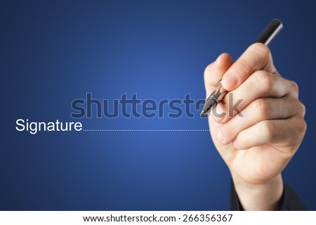 Fingers holding pen writing signature - stock photo