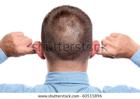 Fingers in Ear. Not listening - stock photo