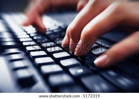 Fingers on keyboard - stock photo