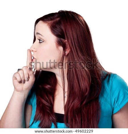 Fingers on lips, woman tells people to be quiet - stock photo