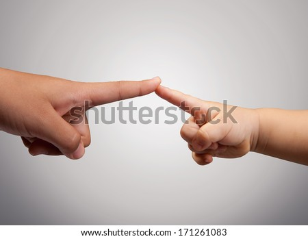 fingers pointing towards each other - stock photo