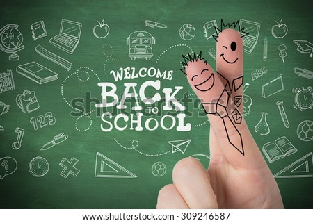 Fingers posed as students against green chalkboard - stock photo