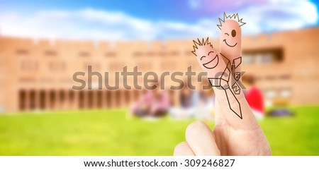 Fingers posed as students against students using laptop in lawn against college building - stock photo