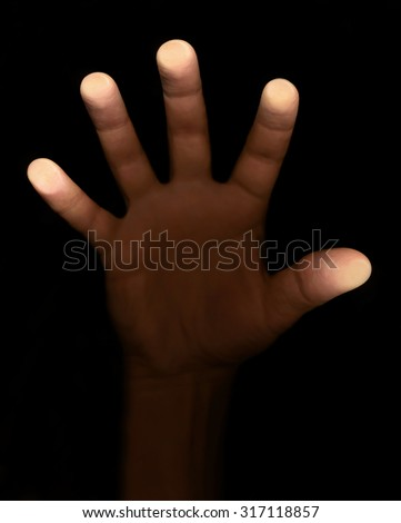 fingers touch the glass on a black background - stock photo