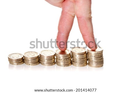 Fingers walking up on stacks of one pound coins on white background. Way to economical growth concept  - stock photo