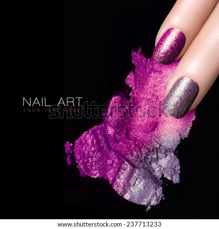 Fingers with silver purple nails and crushed eye shadow with drops of water. Manicure and makeup concept. Closeup image isolated on black with sample text - stock photo