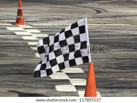 Finish flag on track in racing car - stock photo