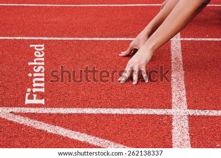 finish - hands on starting line - stock photo