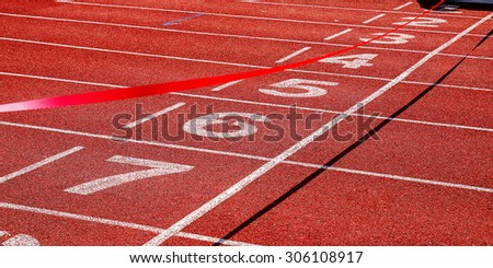 Finish line on the track in the stadium. - stock photo