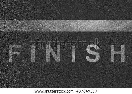 Finish written on running track - stock photo