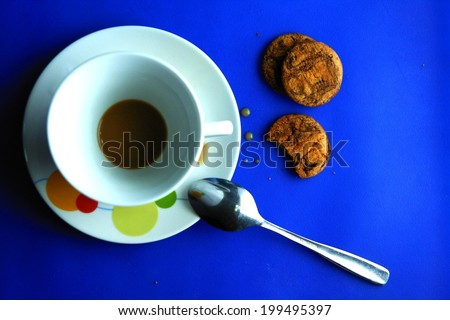 Finished Coffee in a ceramic cup and cookies Photo of a finished or drank coffee in a ceramic cup and saucer, a teaspoon and three cookies - stock photo