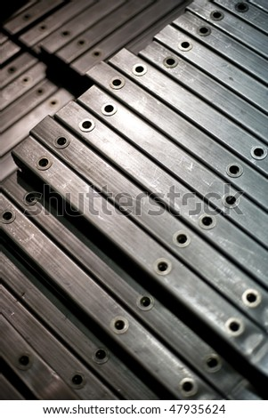 Finished Metal Bars After Coming Off Production Line - stock photo