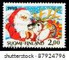 FINLAND - CIRCA 1992: A Christmas stamp printed in Finland shows Santa Claus, circa 1992 - stock photo