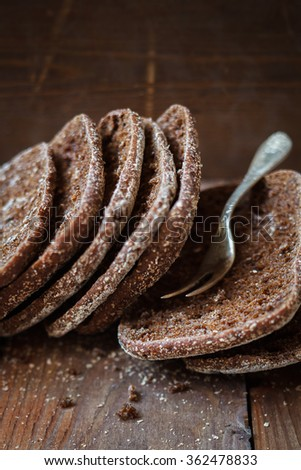 Finnish rye flat bread,rustic background,selective focus - stock photo