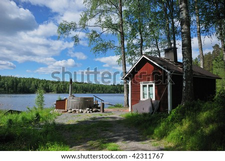 Finnish sauna and outdoor hot tub - stock photo