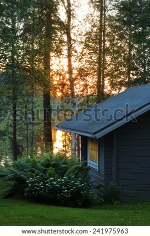 Finnish sauna cottage in luminous midsummer night lakeside - stock photo
