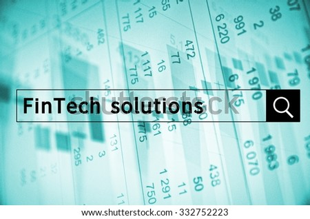 FinTech solutions written in search bar with the financial data visible in the background. - stock photo