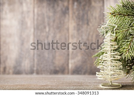 Fir branch and decor, on the wooden background. - stock photo