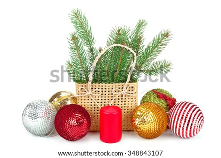 fir branches with balls in the basket, candles isolated on white - stock photo