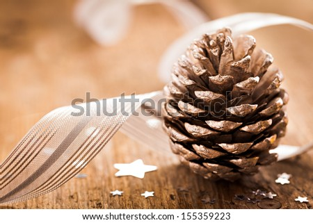 fir cone and ribbon for christmas - stock photo