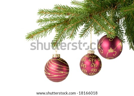 Fir tree branch with decoration on a white background. Close up. Christmas decoration. - stock photo