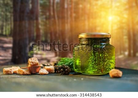 Fir tree bump jam on wooden background - stock photo