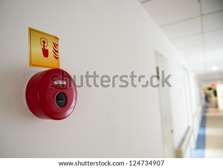 fire alarm on the wall of hospital. - stock photo