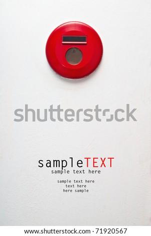 Fire alarm signal on white wall - stock photo