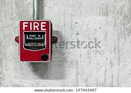 Fire alarm switch on factory wall - stock photo
