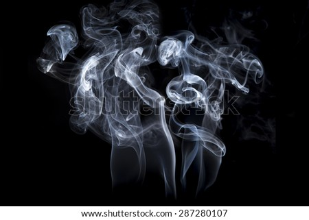 Fire and smoke isolated with light on black background - stock photo