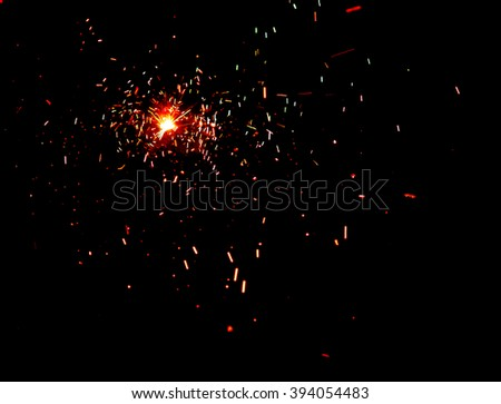 fire and sparks on a black background. - stock photo