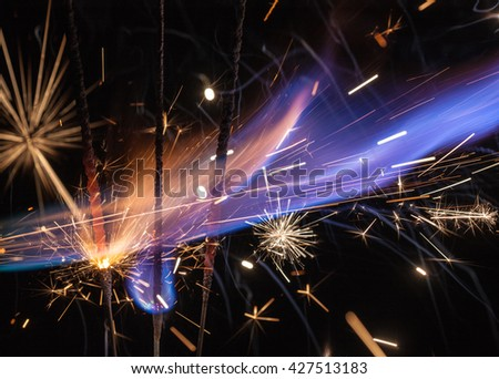 fire and sparks on a black background - stock photo