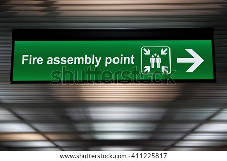 Fire assembly point sign - stock photo