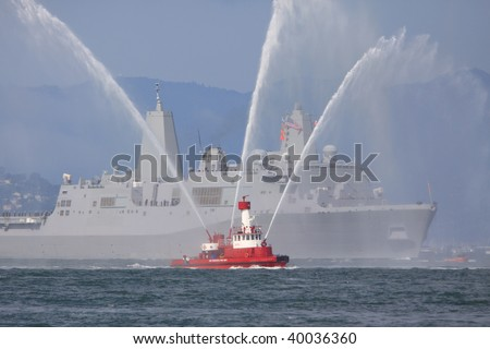 Fire-boat and warship - stock photo