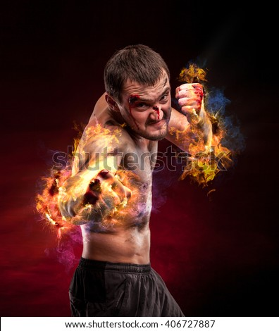 Fire boxer standing staring strong. Young masculine caucasian male athlete.  - stock photo