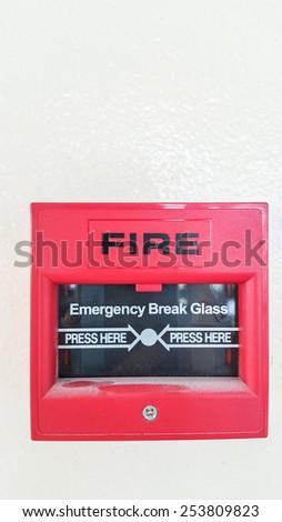 fire break glass on white wall background - stock photo