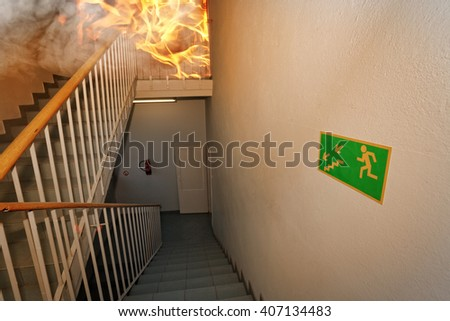 Fire! - Emergency exit in building - stock photo