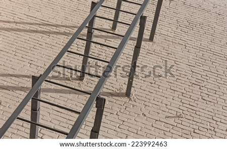 fire escape at an old apartment building wall - stock photo
