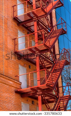 Fire escape on the facade of the new office building - stock photo