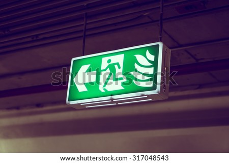 Fire exit ( Filtered image processed vintage effect. ) - stock photo