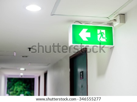 fire exit sign, focus fire exit sign - stock photo