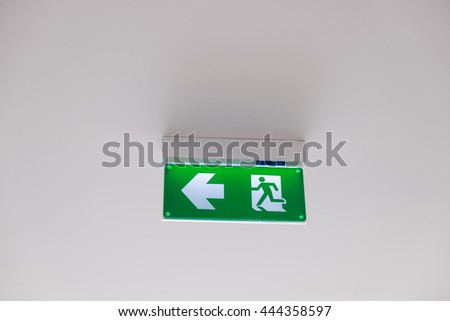 fire exit sign, focus fire exit sign. - stock photo