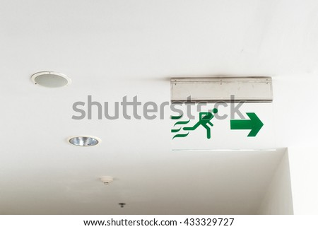 Fire Exit Signs on The ceiling - stock photo